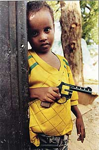 """Boy with Gun."" (Photo Credit: Dan Eldon, via MarketWire)"