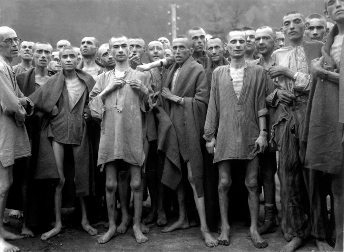 Starved prisoners, nearly dead from hunger, pose in concentration camp in Ebensee, Austria. (Photo Credit: Arnold Samuelson via National Archives)