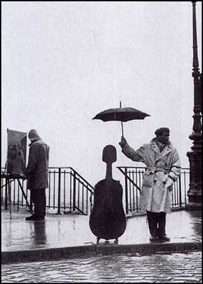 'Musician in the Rain.' (Photo Credit: Robert Doisneau)